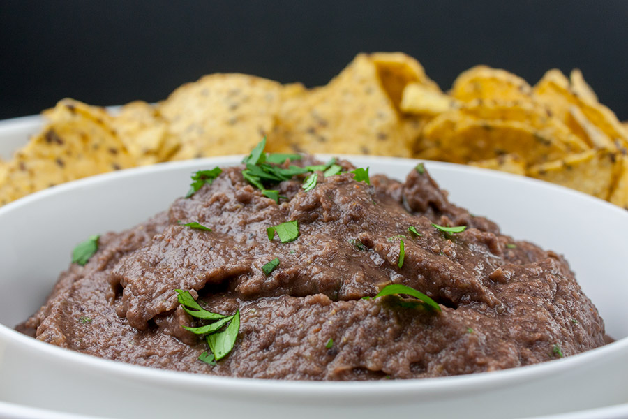 Easy Black Bean Dip - Ready in under 5 minutes. It's great for any party, gathering or just simple Taco Tuesday at home! A simple,creamy black bean dip packed with Southwestern flavor.