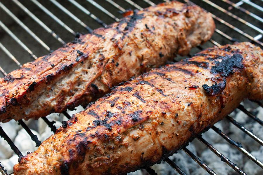 Grilled Adobo Pork Tenderloin - Cooked pork tenderloin on a grill