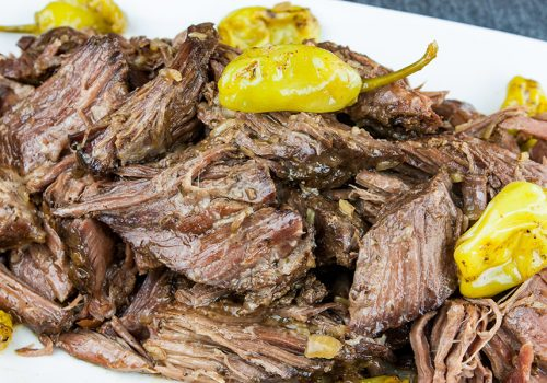 Crock Pot Mississippi Pot Roast - Five simple ingredients bring the perfect flavor combination to this juicy, tender pot roast. You're going to love this recipe!