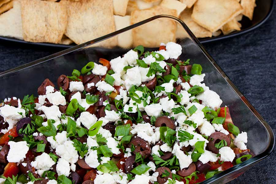 Easy Mediterranean Dip - top view of the dip with pita chips in the background