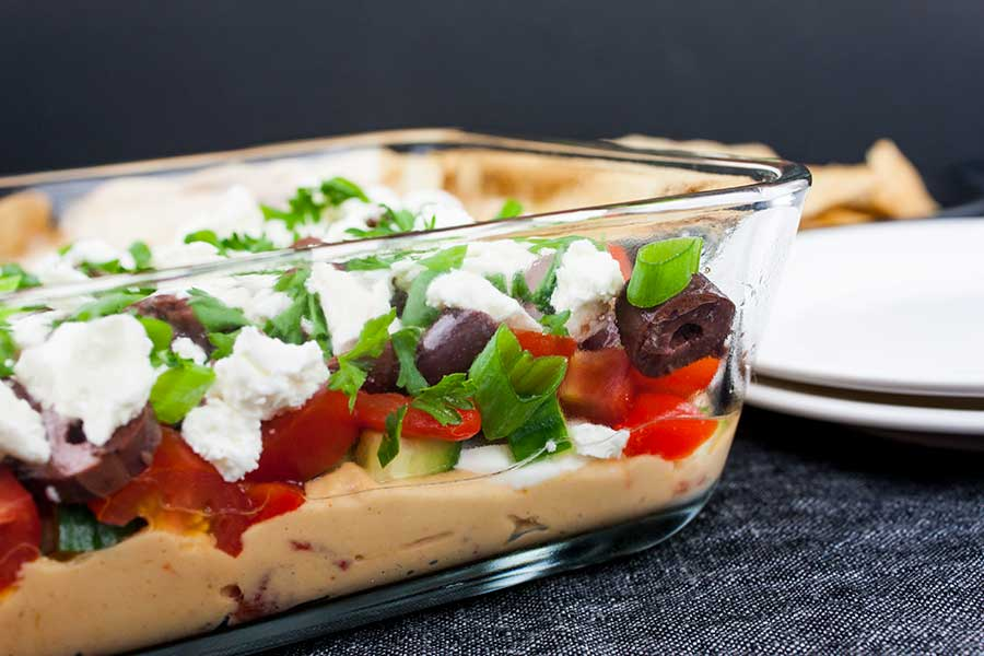 Easy Mediterranean Dip - side view of the serving dish showing the layers of dip