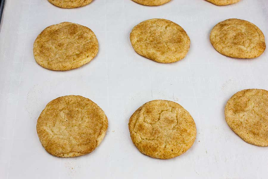 Best Chewy Snickerdoodle Cookies - baked cookies on the parchment-lined baking sheet