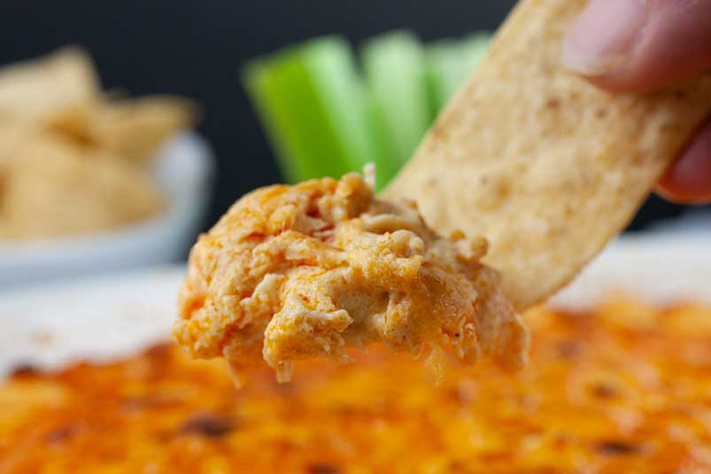 Buffalo Chicken Dish - dipped scooped on a tortilla chip