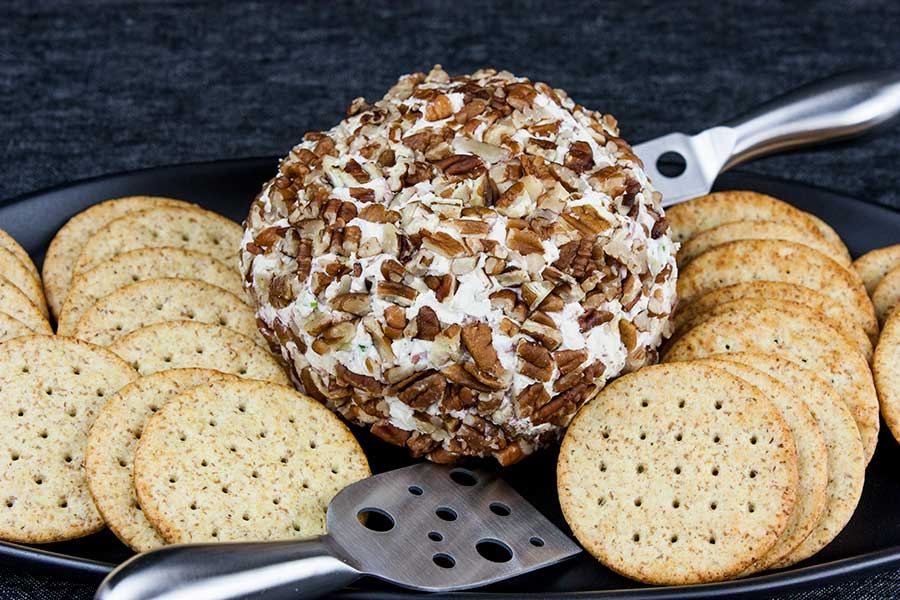 Best Cheese Ball Recipe - Six simple ingredients are all you need to make the best cheese ball recipe! Even better, it takes just minutes to make. It's the perfect make-ahead appetizer. Holiday gatherings, parties, game day events, etc!
