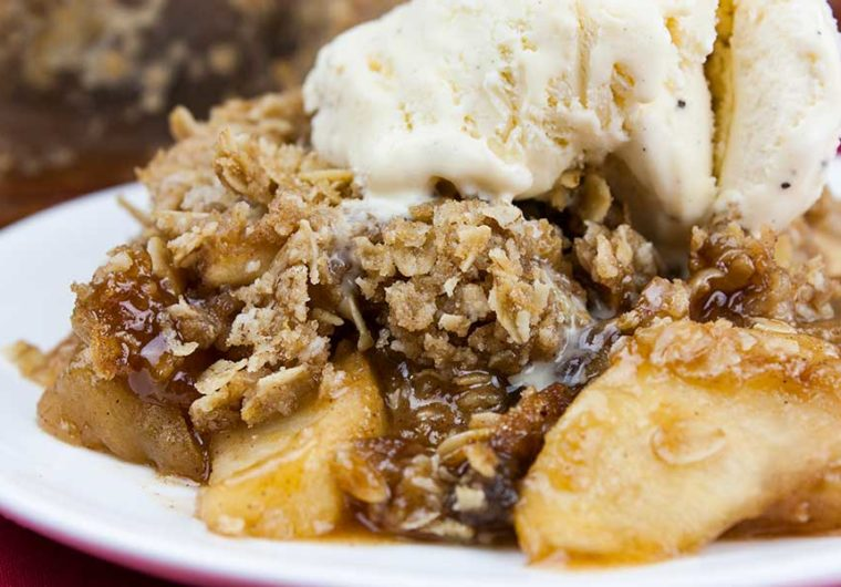 Classic Apple Crisp - Thinly sliced cinnamon-spiced apples baked to perfection and topped with a sweet crunchy oat crumble. Easy to make and a no-fuss way to apple pie flavors.