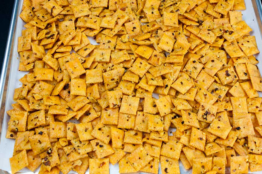 Firecracker Cheez-Itz - crackers on a parchment lined baking sheet