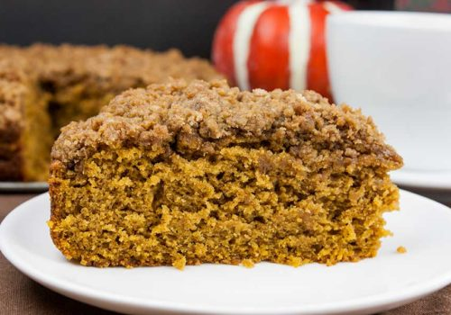 Pumpkin Coffee Cake - Pour a cup of coffee and take a break with a piece of this incredibly moist, flavorful pumpkin coffee cake loaded with a crumb topping. This is a fall baking must!