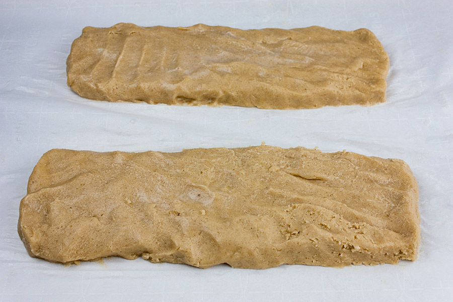 Spiced Apple Cider Biscotti - dough formed into two logs on parchment paper
