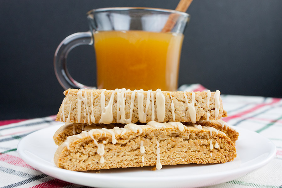 Spiced Apple Cider Biscotti - biscotti on a white plate with a glass mug of hot apple cider