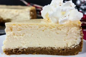 Eggnog Cheesecake with Gingersnap Crust - Thick, rich, creamy, and full of classic eggnog flavor! This recipe features the traditional warm spice flavors of the holidays. A perfect way to indulge during the season!