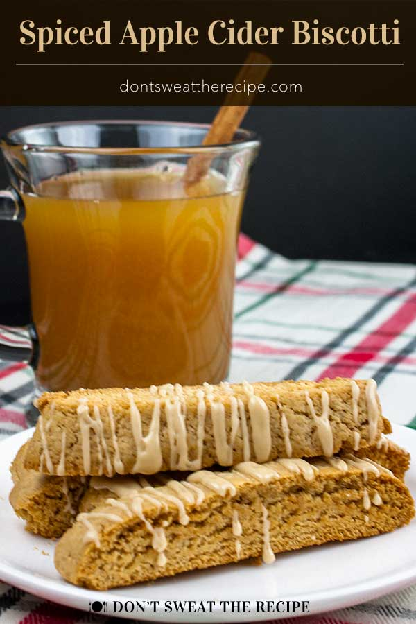 Spiced Apple Cider Biscotti - The perfect fall biscotti recipe for your cookie jar! Boiled apple cider gives this biscotti an intense apple flavor. #cookies #fall #dessert #thanksgiving #christmas #recipe
