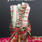A super easy and fun treat to make and gift for Christmas. Chocolate Covered Pretzel Rods are a beautiful, edible, salty-sweet treats everyone loves! #pretzelrods #chocolate