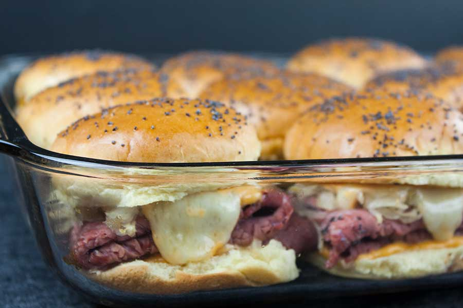 Pastrami And Swiss Cheese Sliders - This pastrami and swiss cheese slider recipe delivers all the flavors. It's perfect for any kind of get-together, movie night, or tailgate party.