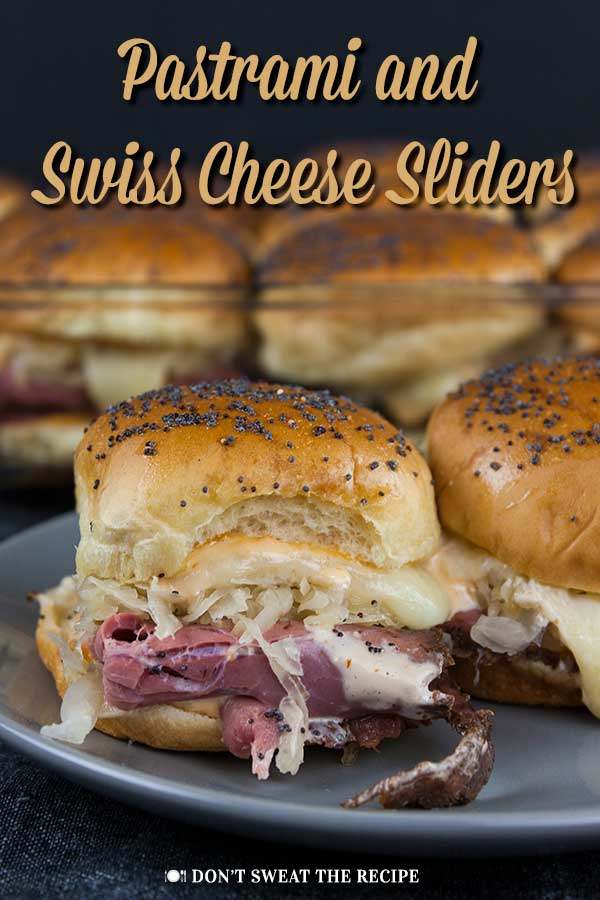 Pastrami And Swiss Cheese Sliders - This pastrami and swiss cheese slider recipe delivers all the flavors. It's perfect for any kind of get-together, movie night, or tailgate party.  #sliders #sandwiches #pastrami #cheese #tailgating