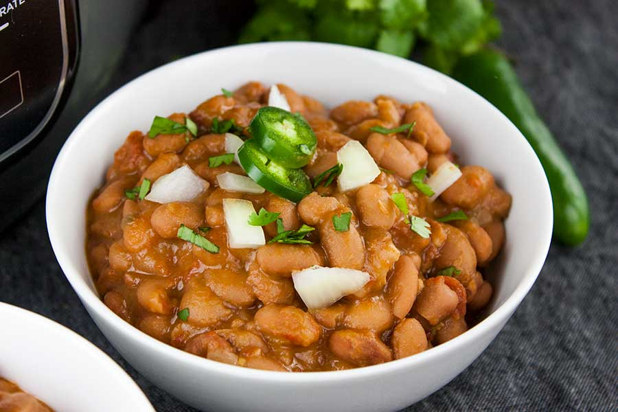 Ninja Foodi Mexican Pinto Beans (Charro Beans) - Such an easy recipe to spice up pinto beans. Perfect side dish to any Mexican meal! Hearty enough to be the main meal.