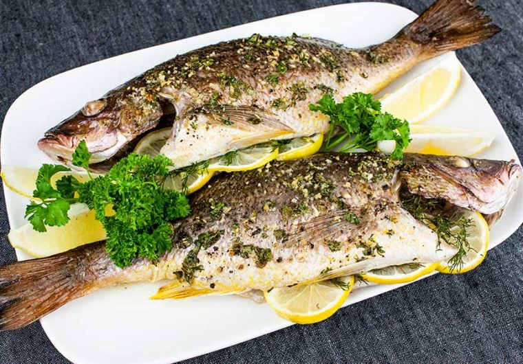 Baked Whole Red Snapper - Deliciously seasoned with citrus and herbs this red snapper recipe is on the table in minutes!