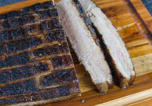 Step up your grill game by serving up some deliciously rendered down smoked pork belly. It's so rich and decadent, everybody will rave!
