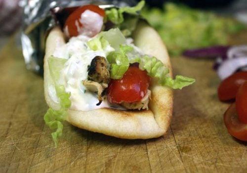 Chicken Gryos - Greek marinated chicken, stuffed in homemade naan, topped with fresh tzatziki sauce! So good!