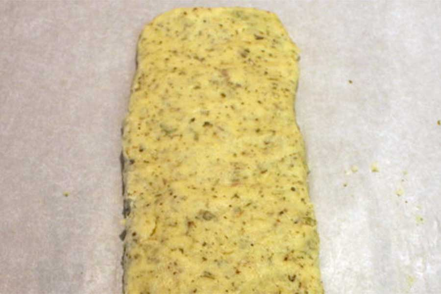 Savory Herb and Cheese Biscotti dough formed into a log