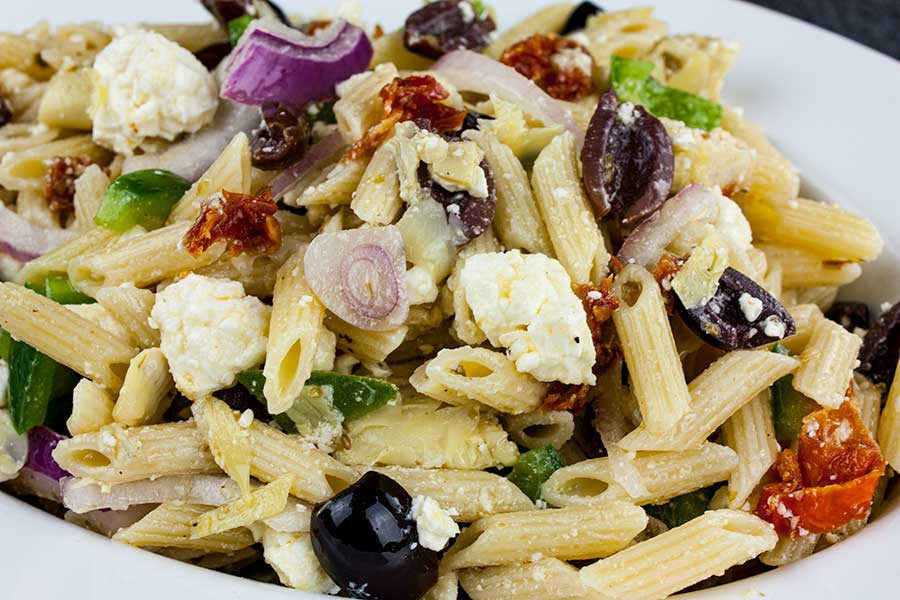 Greek Pasta Salad - A light, fresh, flavor-packed salad perfect for summer or any time of the year! Great to feed a crowd.