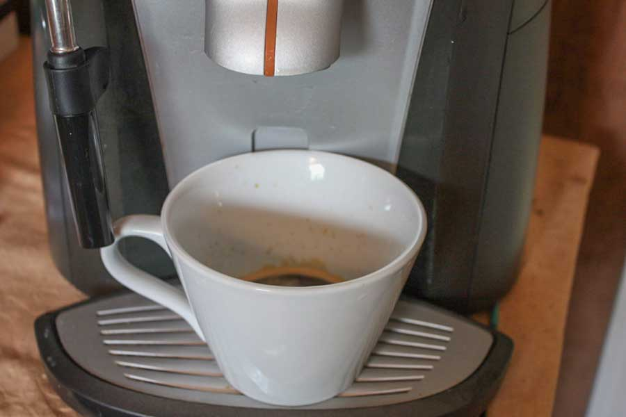 espresso being pulled into a white cup