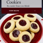 A soft, delicate, slightly crisp cookie base filled with sweet, tangy red raspberry jam! This easy Red Raspberry Thumbprint Cookie recipe is a Christmas tradition. #cookies #christmas