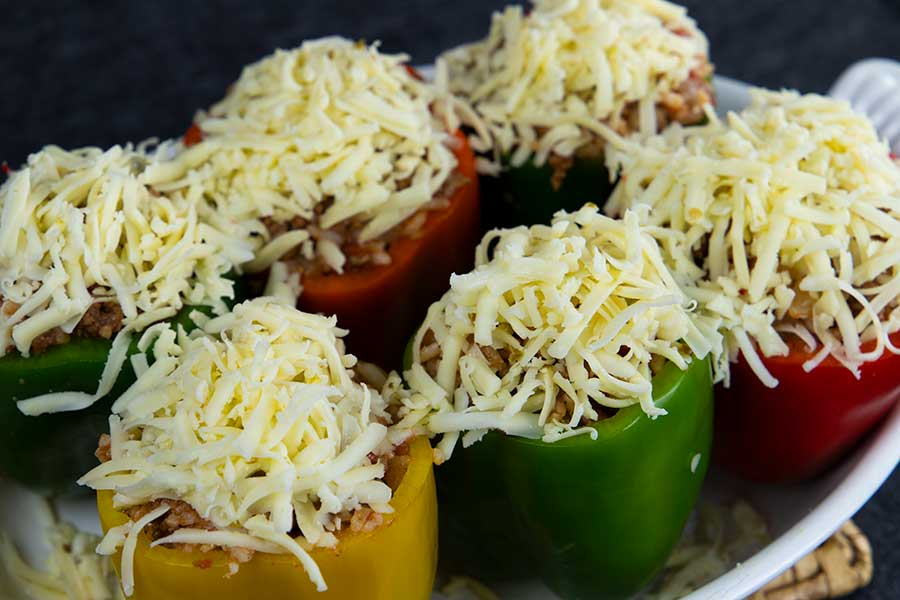 Stuffed bell peppers covered with cheese.