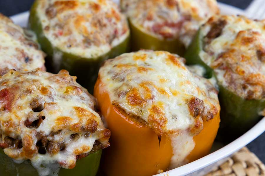 Stuffed bell peppers in a white baking dish