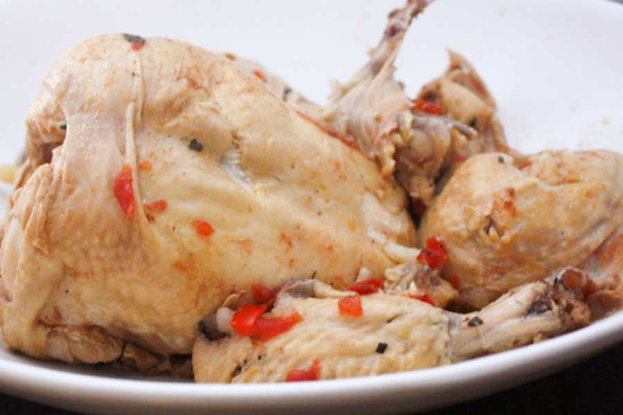 Cooked chicken on a white platter ingredient for Sicilian chicken noodle soup