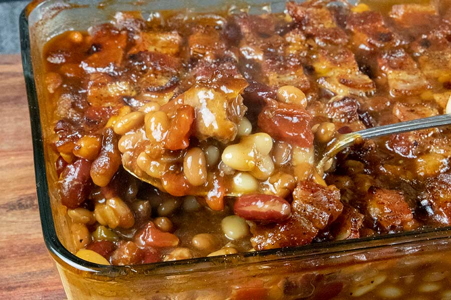 Cooked baked beans in a casserole dish.