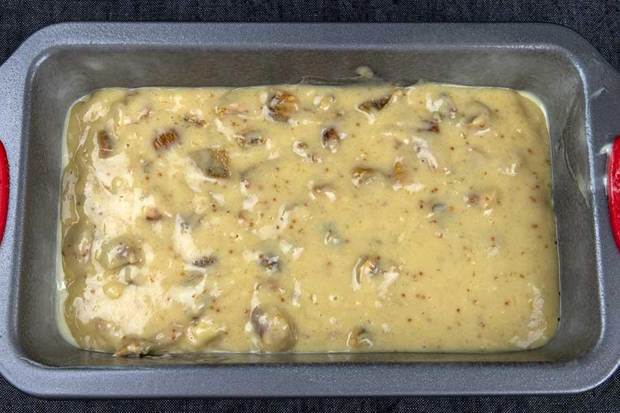 walnut fig bread batter in a loaf pan