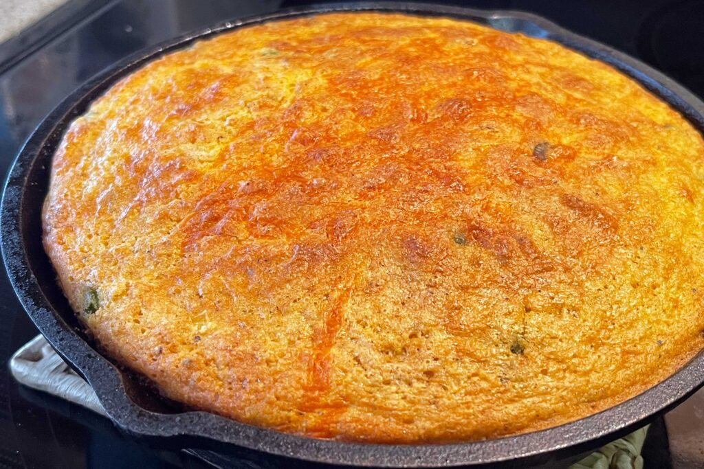 Cooked cornbread in a cast iron skillet