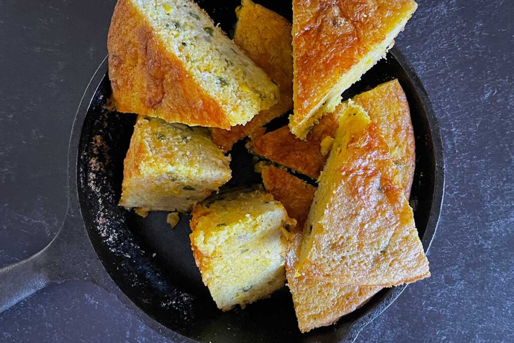 Cornbread wedges in a cast iron skillet