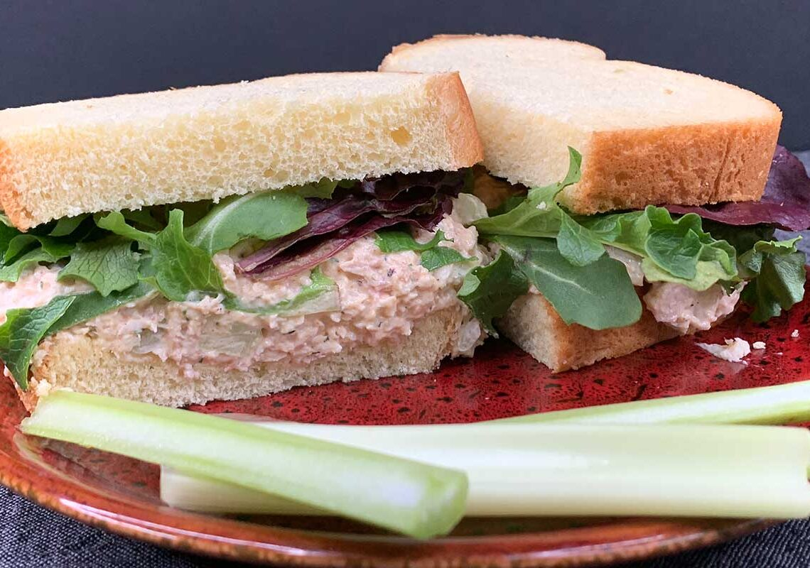 smoked chicken salad sandwich on a red plate