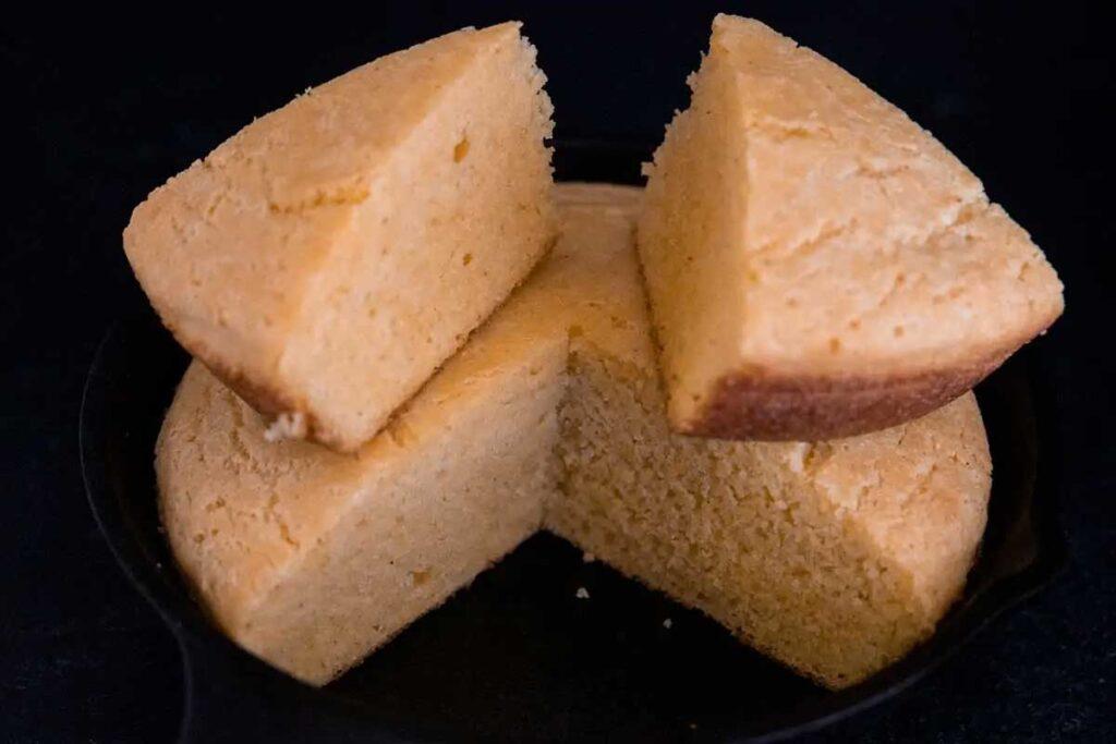 Sliced buttermilk cornbread in a cast iron skillet