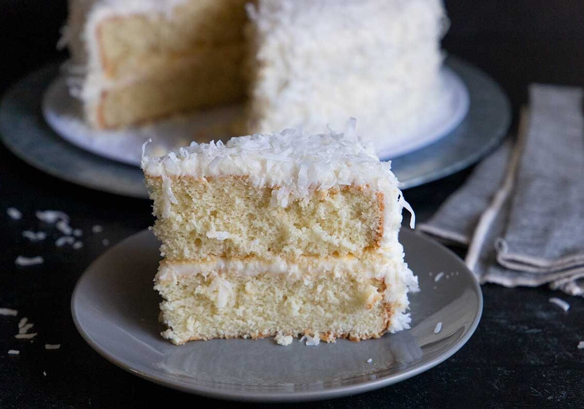 slice of coconut cake on a gray plate