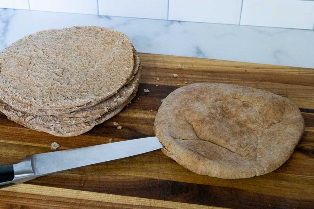 Cutting a pita into two pieces