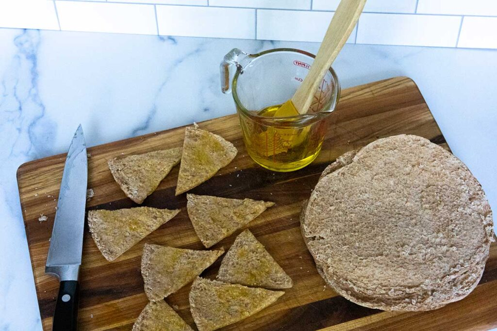 Brushing pita bread with olive oil