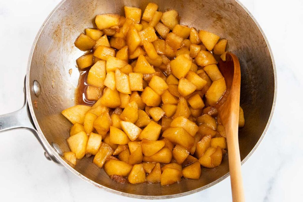 chopped apples cooked in a saucepan