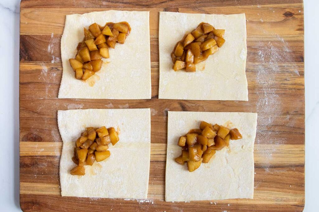 puff pastry cut into squares with apple filling in the middle