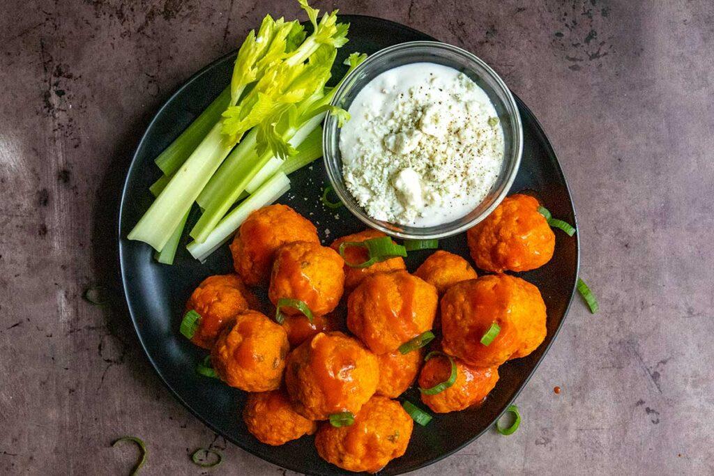 Buffalo chicken meatballs with garnish