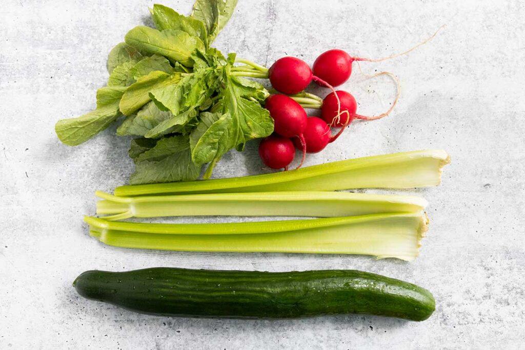 fresh cucumber, radishes, and celery