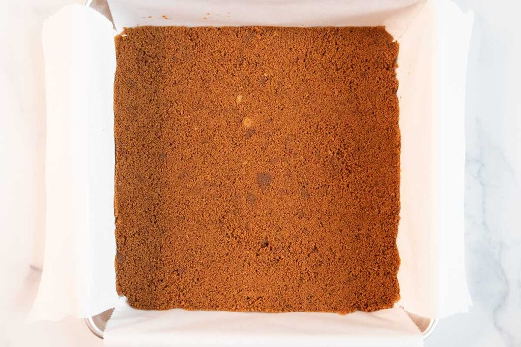 gingersnap cookie crust in a baking pan