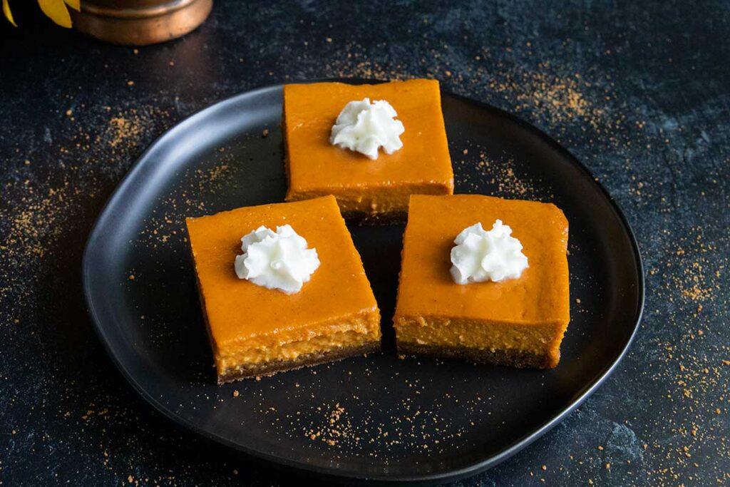 pumpkin pie bars on black plate