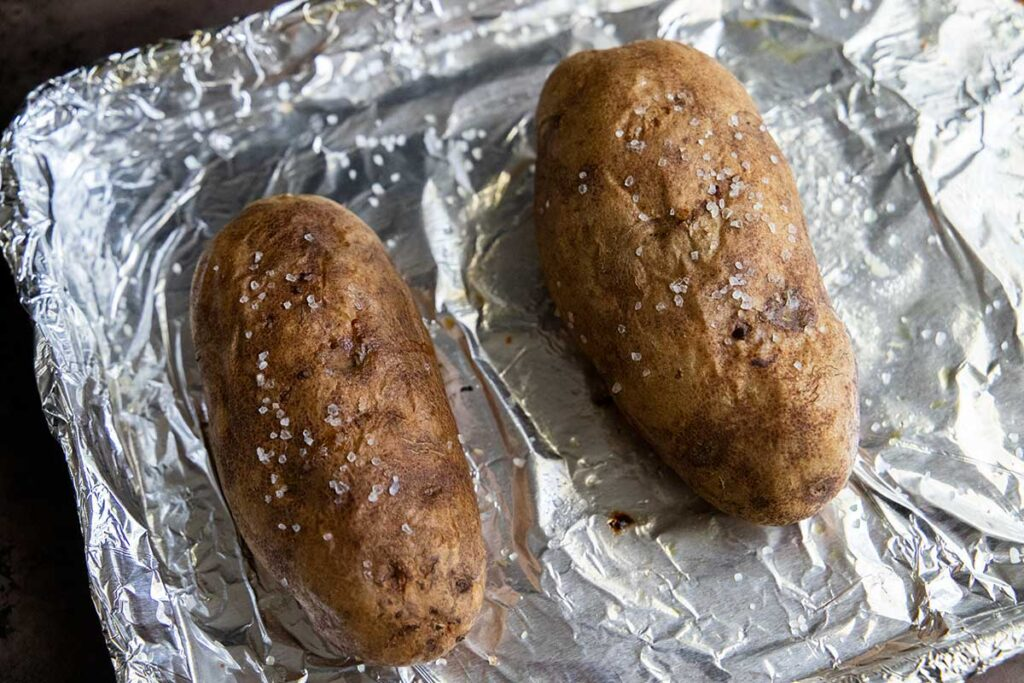 Potatoes on a foil lined baking sheet