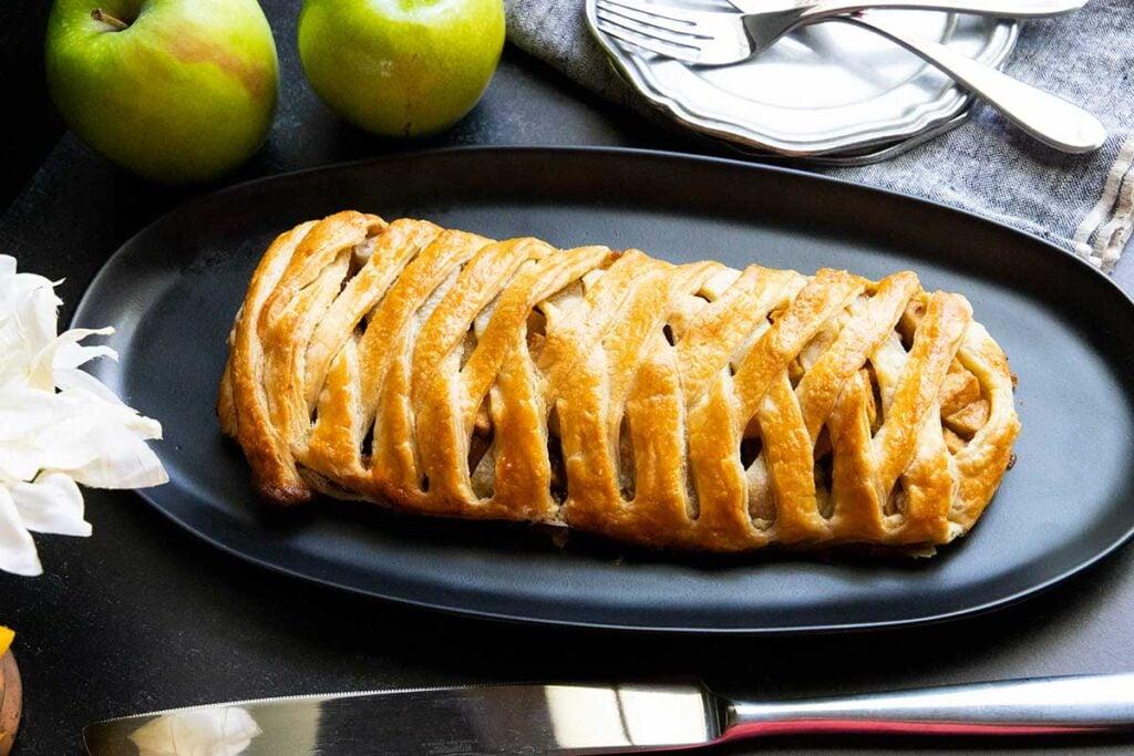 apple strudel on black platter