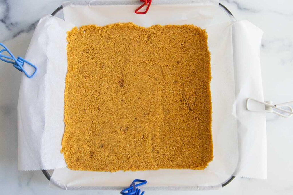 graham cracker crust in a baking dish
