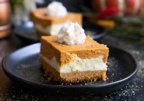 pumpkin cheesecake bar on a black plate