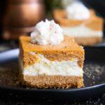 pumpkin cheesecake bars on a black plate