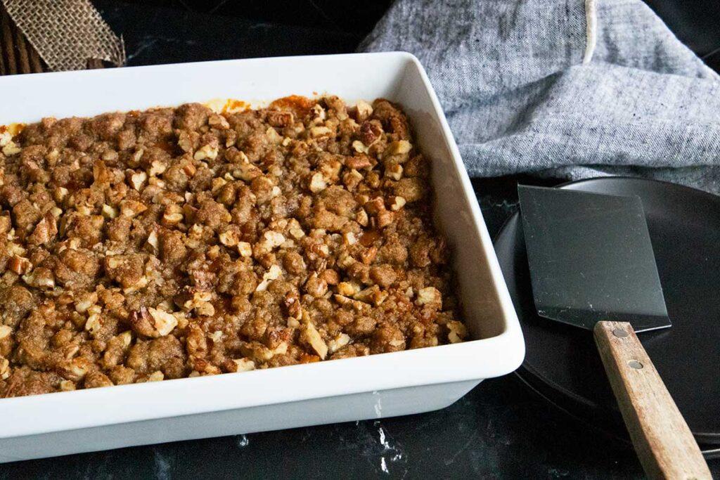 sweet potato casserole in white baking pan